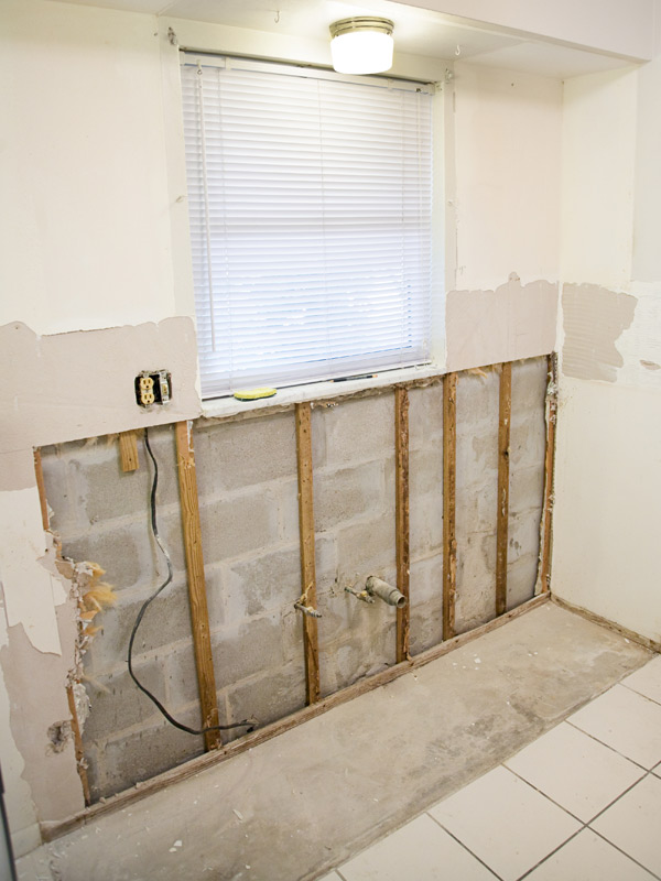 A section of moldy drywall has been removed as part of a mold remediation project