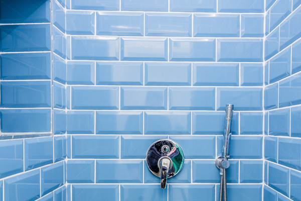 Bathroom tiled shower with shiny clean tiles and grout