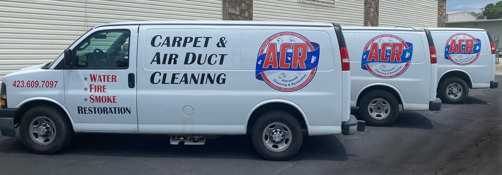 Three carpet cleaning vans with ACR logo in Greeneville, TN